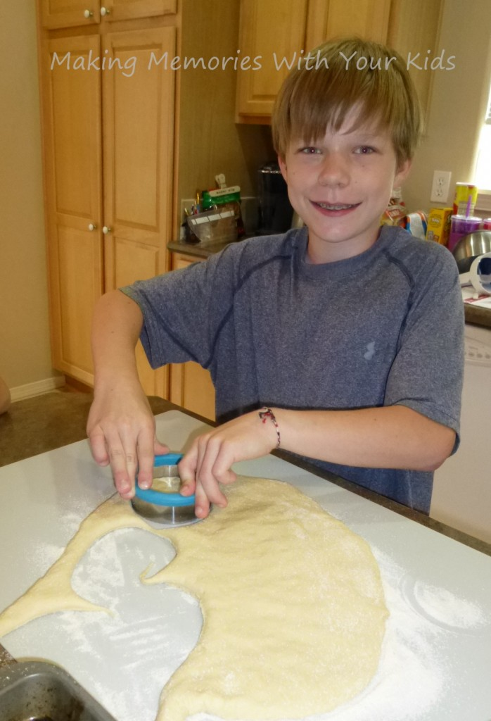 cutting out english muffin dough