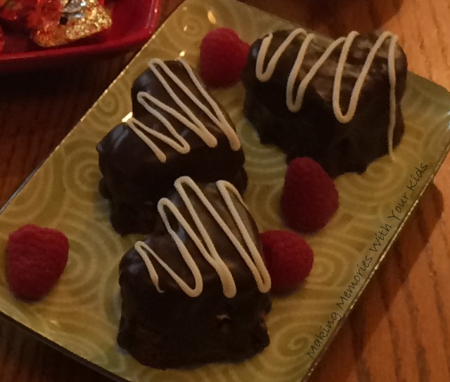 Heart Shaped Brownies Filled with Cream Cheese Frosting and Covered in Ganache for Valentine's Day